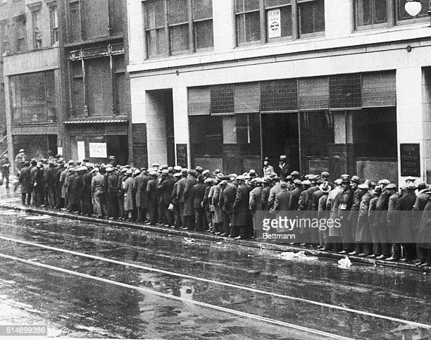 Unemployed men wait in long lines for bread and handouts during the Great Depression.