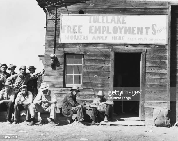 Unemployed men waiting outside the California State Employment Service office at Tulelake Siskiyou County California September 1939