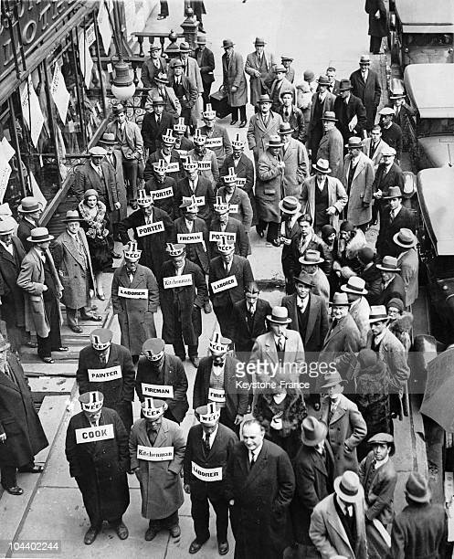Unemployed persons demonstrated in Times Square New York They are wearing signs which state their professions and which offer to work for a dollar a...