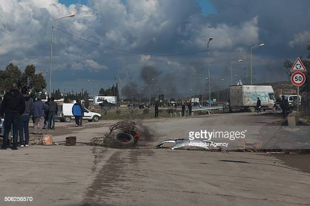Unemployed protestors burn tires and make a barricade during the nationwide protest in Tunis Tunisia on January 22 2016