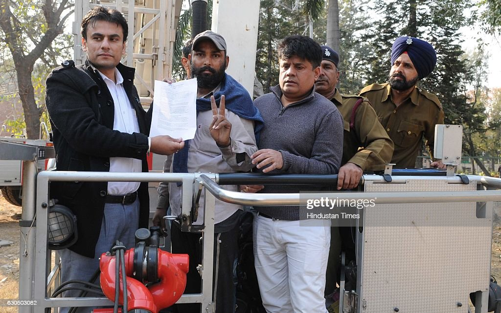 Unemployed teacher Deepak Kumar showing his appointment letter as he climbed down from a mobile tower at Punjab Bhawan sector 3 on December 24 2016...