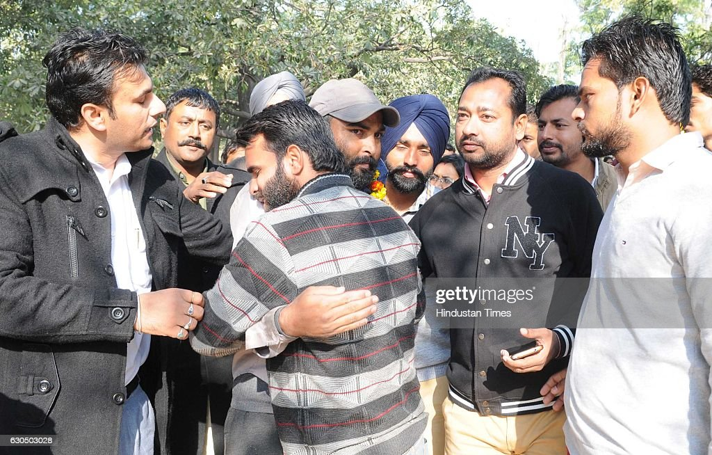 Unemployed teacher Deepak Kumar with his friends after climbing down from a mobile tower at Punjab Bhawan sector 3 on December 24 2016 in Chandigarh..