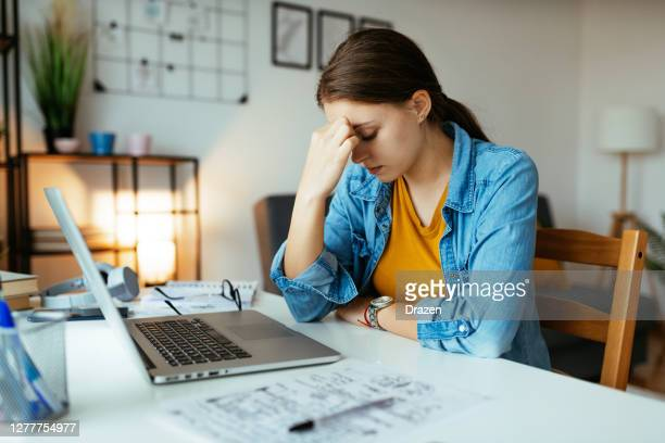 unemployed woman expressing negative emotions during recession. jobless woman looking vacancies online with no success - youth culture stock pictures, royalty-free photos & images