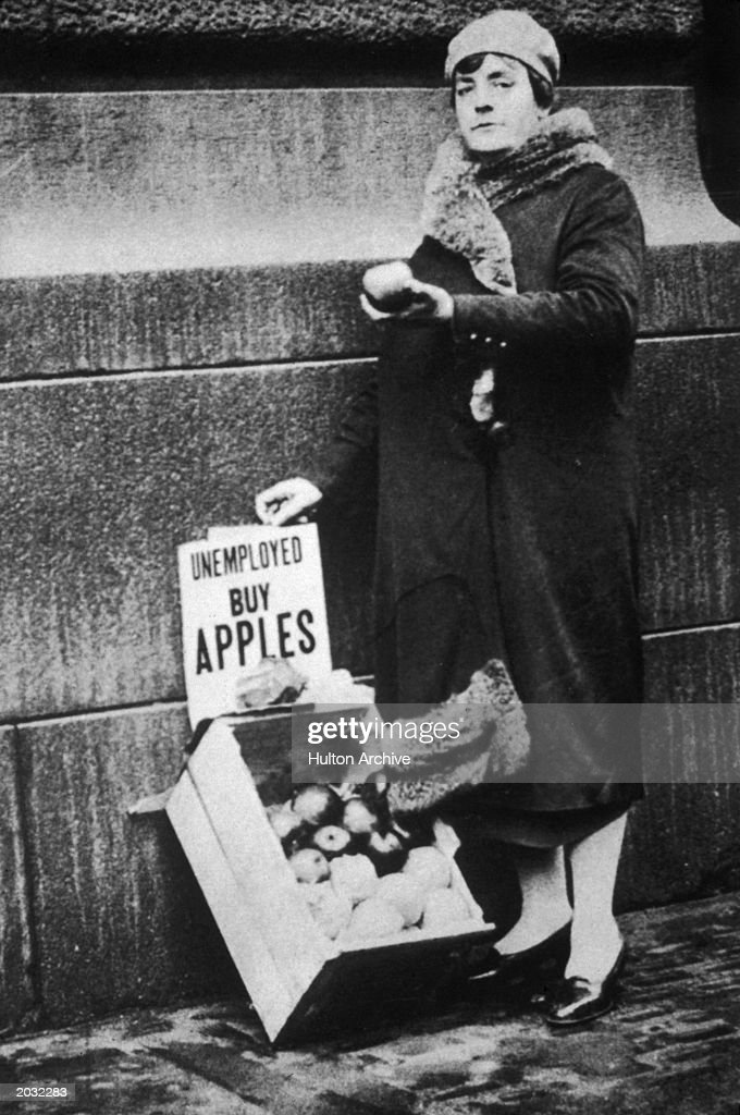 Unemployed woman selling apples during the Depression; New York City, New York, 1929.
