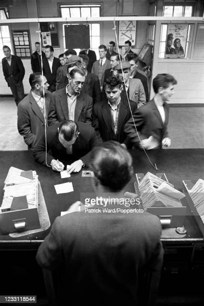 Unemployed workers signing on at the Labour Exchange in Greenock, Scotland, circa May 1969. From a series of images to illustrate the many...
