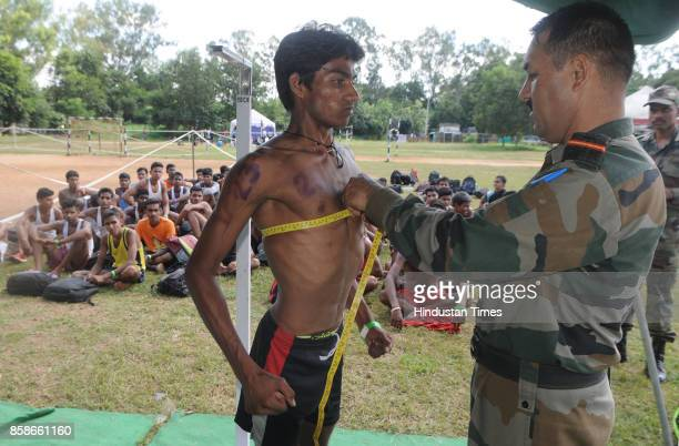 Unemployed youth take part in the physical test during a special recruitment camp of the Indian Army at Morahbadi Ground on October 7 2017 in Ranchi...