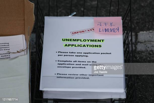 Unemployment applications are seen as City of Hialeah employees hand them out to people in front of the John F. Kennedy Library on April 08, 2020 in...
