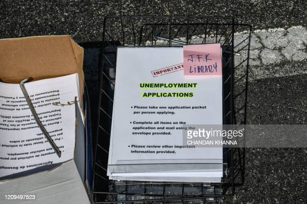 Unemployment forms are seen kept at a drive thru collection point outside John F Kennedy Library in Hialeah Florida on April 8 2020