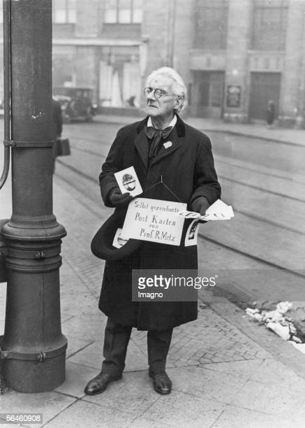 Unemployment in Weimar Republic Unemployed music professor is selling post cards drawn by himself on Leipziger square in Berlin in order to earn a...