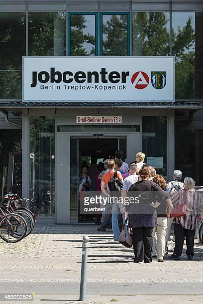 unemployment office with lot of unemployed people in berlin - werkloosheid stockfoto's en -beelden