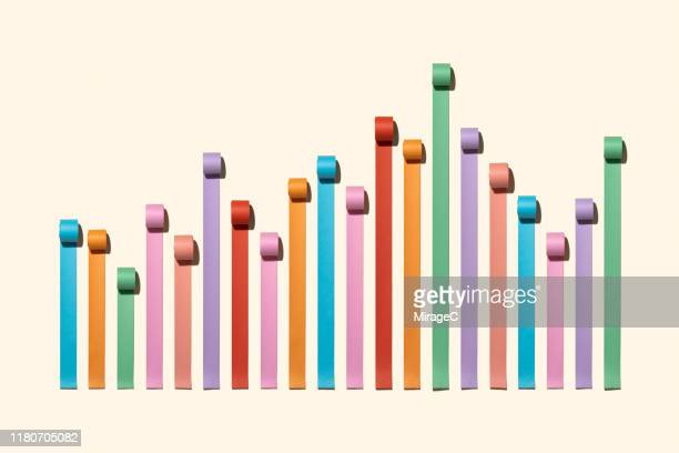 uneven chaos bar chart made of paper rolls - data stock pictures, royalty-free photos & images