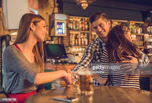 unfaithful young man in a cafe. - bigamy stock pictures, royalty-free photos & images