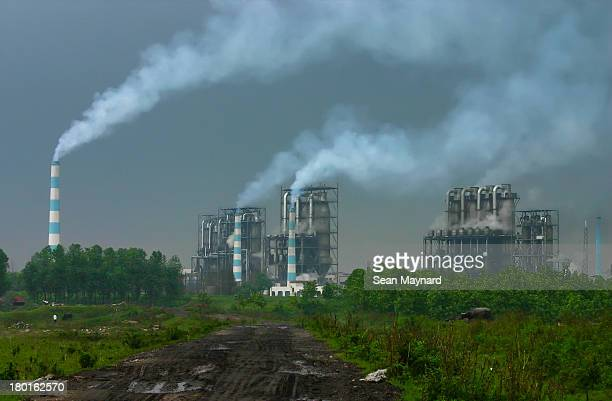 CONTENT] Unfiltered pollution is emitted from chemical plant smoke stacks in the city of Shishou in China's Hubei Province On most days the...