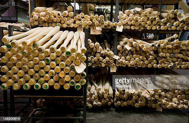 Unfinished bats sit on racks at the Louisville Slugger Museum and Factory in Louisville Kentucky US on Friday July 13 2012 The Louisville Slugger...