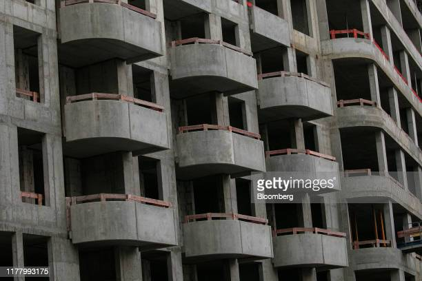 Unfinished concrete balconies stand during construction as part of the Upside Berlin development in the Friedrichshain district of Berlin Germany on...