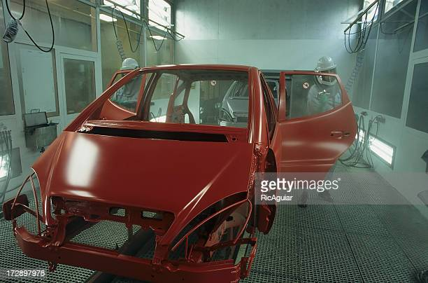 Unfinished frame of red car in auto shop