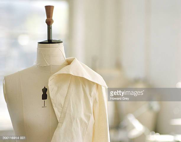 Unfinished garment pinned to dressmaker's dummy
