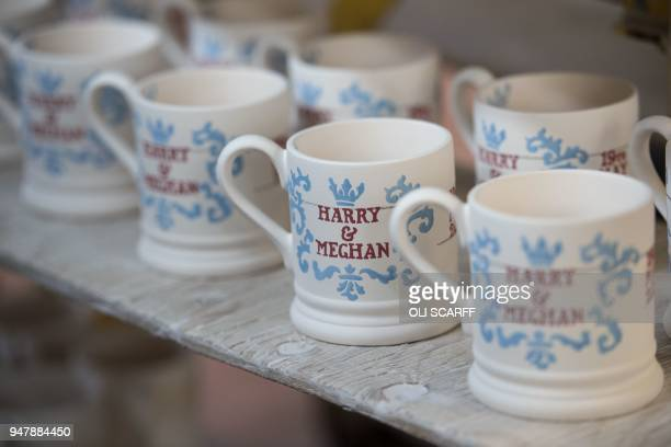 Unfinished handpainted commemorative mugs with a message celebrating the forthcoming wedding of Britain's Prince Harry and his US fiance Meghan...