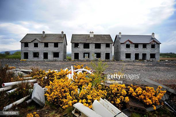 'BEST PHOTOS OF 2012' Unfinished homes sit empty on an abandoned housing development in Keshcarrigan Ireland on Monday April 23 2012 Ireland's...