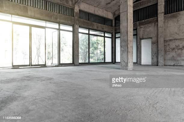 unfinished modern building interior - zement stock-fotos und bilder