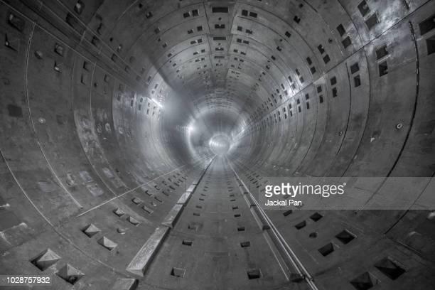 unfinished subway tunnel - tunnel stock-fotos und bilder