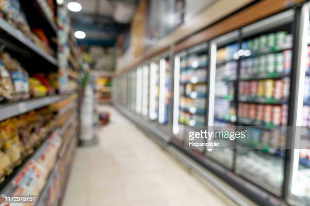 unfocused shot of aisle at a supermarket - aisle stock pictures, royalty-free photos & images