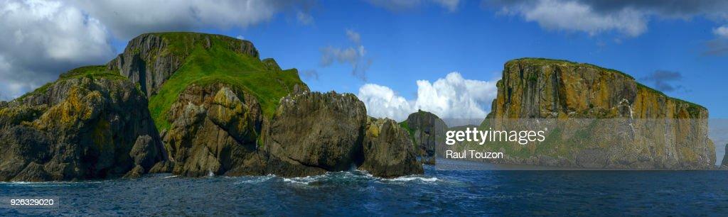 Panoramic view of cliffs of Unga Island. : Stock Photo