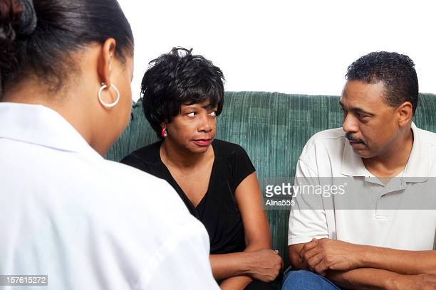 Unhappy african-american couple at the marriage counselor on white
