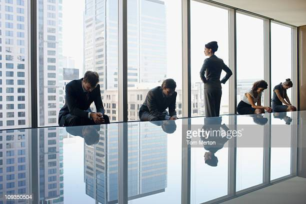 Unhappy business people sitting in conference room