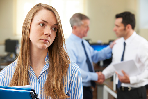 Unhappy Businesswoman With Male Colleague Being Congratulated 494416863