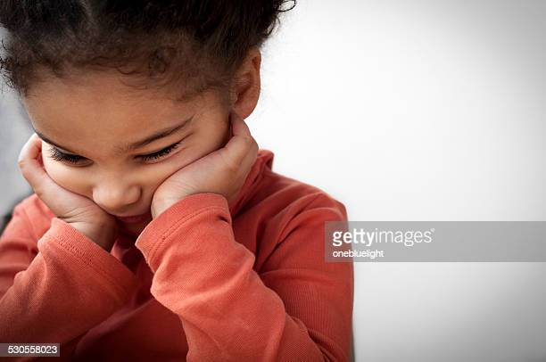 unhappy child (4-5)  with her head in hands - sulking stock pictures, royalty-free photos & images
