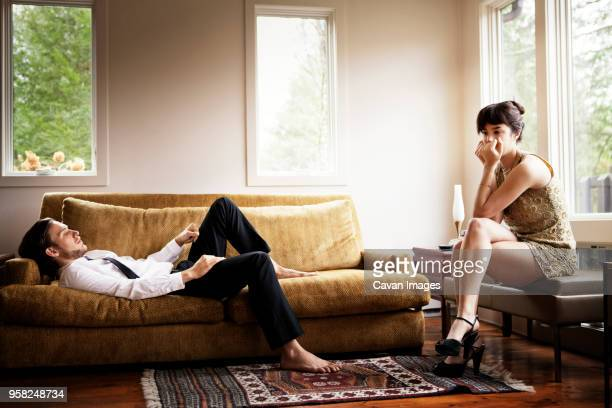 unhappy couple in living room - relationship difficulties stock pictures, royalty-free photos & images