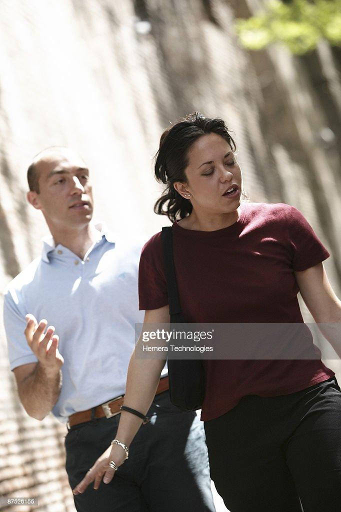 Unhappy couple outdoors : Stock Photo