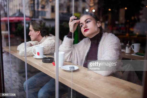 Unhappy Couple Sitting At Cafe And Breaking Up