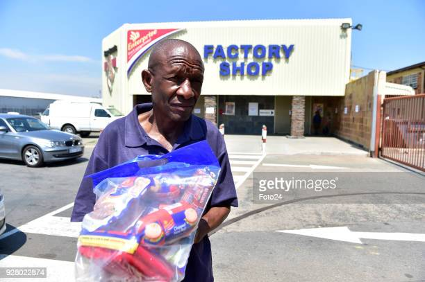 Unhappy customers return products at an Enterprise outlet after a recall by Health Minister Aaron Motsoaledi following a listeria outbreak on March...