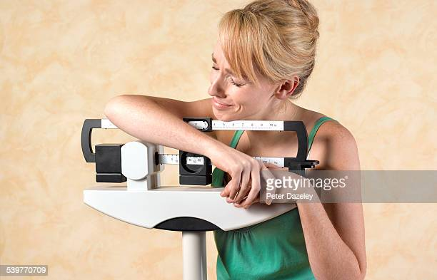 unhappy dieter - dieting stock pictures, royalty-free photos & images