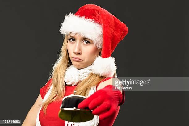 Unhappy girl holding an empty purse