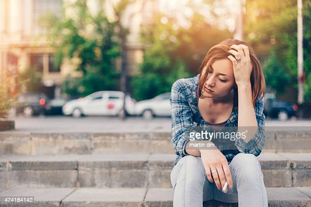 unhappy girl - little girl smoking cigarette stock photos and pictures
