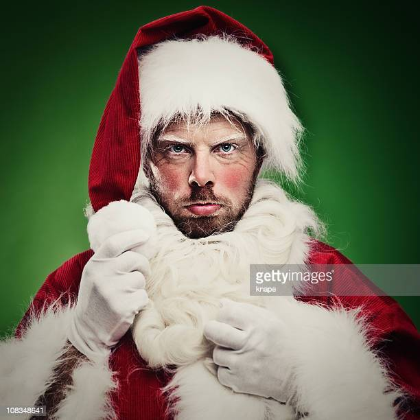 Unhappy man dressed up as Santa Claus