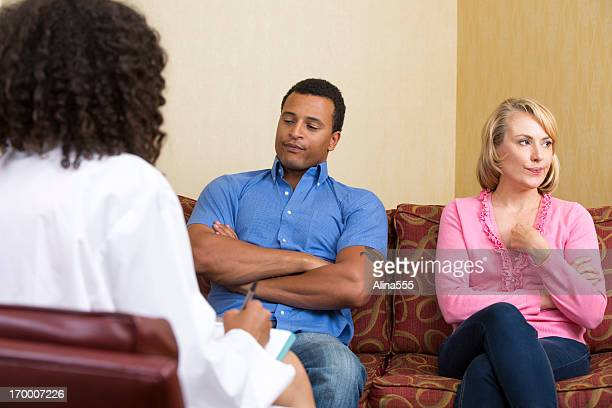 Unhappy mixed-race couple at the marriage counselor