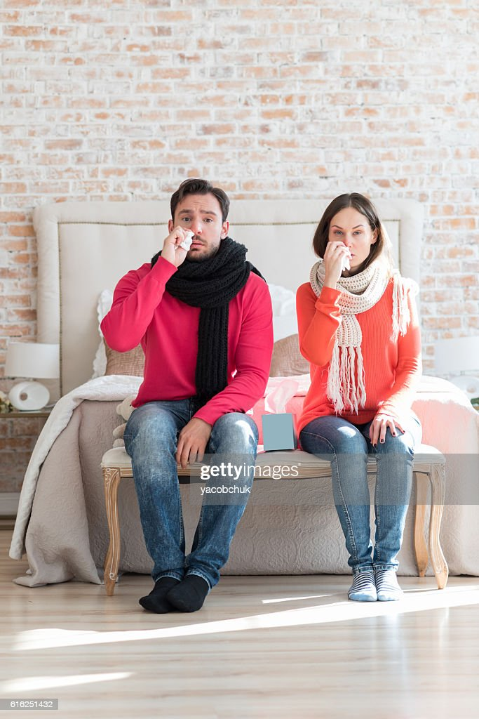 Unhappy sad couple suffering from flu : Stock Photo