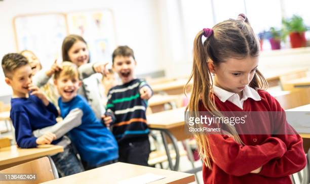 unhappy schoolgirl - sneering stock pictures, royalty-free photos & images