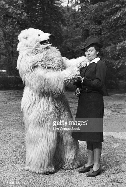 Unhappy woman dances with person in a polar bear costume German ca 1935