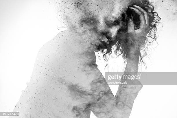 unhappy woman's form double exposed with paint splatter effect - pijn stockfoto's en -beelden