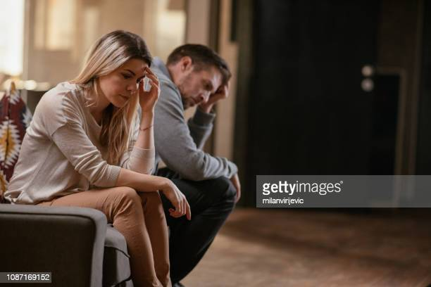 unhappy young couple - sadness stock pictures, royalty-free photos & images