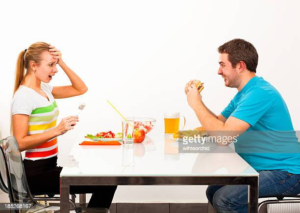 unhealthy and healthy food - skinny man fat woman stock pictures, royalty-free photos & images