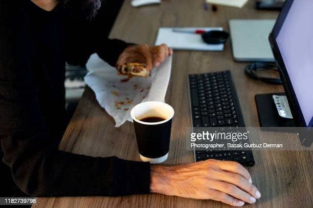 unhealthy eating in the office - lunch stock pictures, royalty-free photos & images