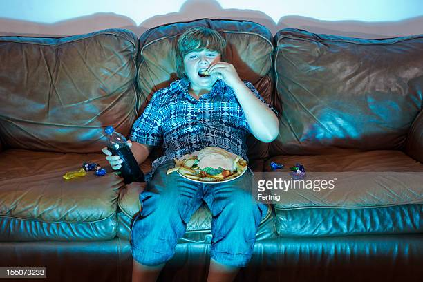 unhealthy eating - chubby boy stock photos and pictures