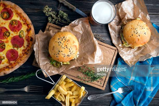 unhealthy food ready to eat - fast food restaurant stock pictures, royalty-free photos & images