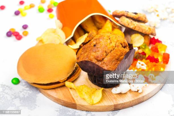 unhealthy junk food - bulimia stock photos and pictures
